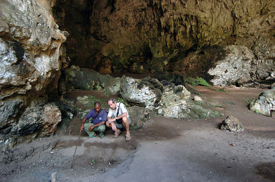 "04 MAY 2005 RAMPAPASA VILLAGE, FLORES, INDONESIA - Daily Mail journalist Richard Shears and guide Agustinos Mangga in the cave near Rampapasa where ""The Hobbit"", a skeleton of a tiny woman who lived there 18,000 years ago was found - PHOTO: CAMERON LAIRD"