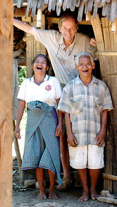 "04 MAY 2005 BEANGIUNG VILLAGE, FLORES, INDONESIA - Daily Mail journalist Richard Shears (6' 1"") with Juliana Mia, 55 and Johannes Jerahi, 65 at the entrance to their family hut.  They believe they are descendants of ""The Hobbit"", a skeleton of a tiny woman who lived in a cave in the area 18,000 years ago - PHOTO: CAMERON LAIRD"