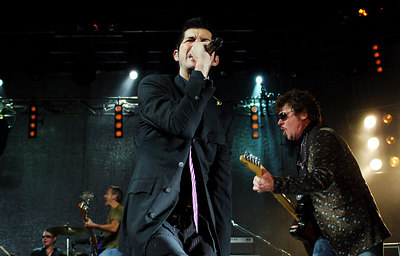 27 AUG 2006 TOWNSVILLE, QLD - INXS frontman JD Fortune and Tim Farris perform during a concert at Townsville Entertainment & Convention Centre - PHOTO: CAMERON LAIRD