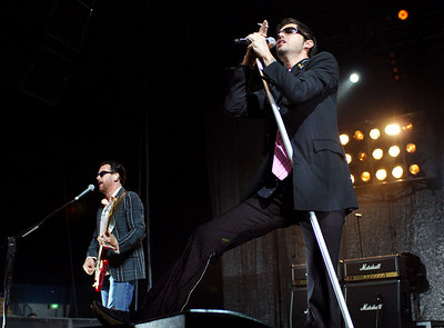 27 AUG 2006 TOWNSVILLE, QLD - INXS frontman JD Fortune and Kirk Pengilly perform during a concert at Townsville Entertainment & Convention Centre - PHOTO: CAMERON LAIRD