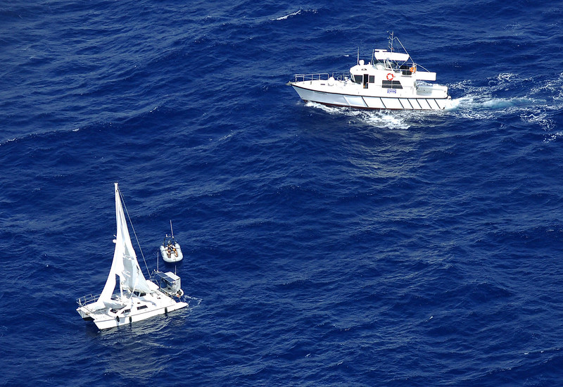 20 APR 2007 TOWNSVILLE, QLD - Water police board Kaz II as it floats 80 nautical miles off Townsville missing its crew of three - PHOTO: CAMERON LAIRD (Ph: 0418 238811)