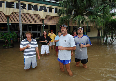 03 FEB 2007 Townsville, QLD - Flooding in the north Queensland sugar town of Giru.  Patrons at the Giru International Hotel, Millworker John Hewitt (front in blue shorts) - PHOTO: CAMERON LAIRD (Ph: 0418238811)