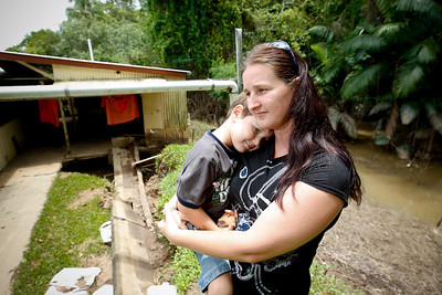 13 February 2009 Cordelia, Qld - Megan Valinoti and son Hayden 4, who both narrowly escaped a rushing torrent of water that flooded in the back of their Cordelia home on the bank of the Herbert River - Photo: Cameron Laird (Ph: 0418 238811)