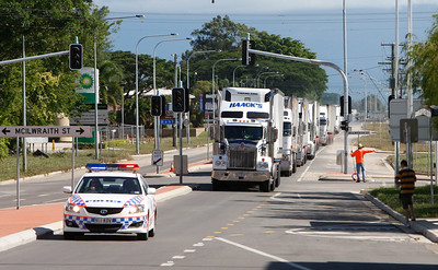 10 February 2009 Townsville, Qld - Flooding has receded in Ingham and locals are cleaning up.  A convoy of trucks pass through Ingham's main street - Photo: Cameron Laird (Ph: 0418 238811)