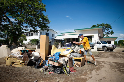 10 February 2009 Townsville, Qld - Flooding has receded in Ingham and locals are cleaning up.  Fred Smith tosses out soiled belongings (Fred 0411243684 or 47980157) - Photo: Cameron Laird (Ph: 0418 238811)