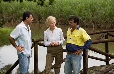14 February 2009 Ingham, Qld - Governer General Quentin Bryce visits flood ravaged Ingham.  Her Excellency talks with twin brothers Tony (blue shirt) and Sam Torrisi who farm sugarcane in the Ingham area - Photo: Cameron Laird (Ph: 0418 238811)