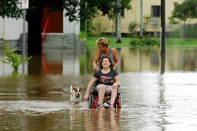 03 FEB 2007 Townsville, QLD - Flooding in the north Queensland sugar town of Giru.  Jane Milton with daughter Ashlee, 10 and dog Sally - PHOTO: CAMERON LAIRD (Ph: 0418238811)