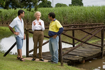14 February 2009 Ingham, Qld - Governer General Quentin Bryce visits flood ravaged Ingham.  Her Excellency and husband Michael Bryce talk with brothers Tony (blue shirt) and Sam Torrisi who farm sugarcane in the Ingham area - Photo: Cameron Laird (Ph: 0418 238811)