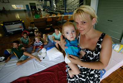 11 February 2009 Ingham, Qld - Ingham flooding cleanup.  Katie Price, 29 with son Jacob and children Nicholas, 3, Jaii, 4, Rachel, 7, Jessica, 9, Kyle, 11 and Amy, 13 - Photo: Cameron Laird (Ph: 0418 238811)