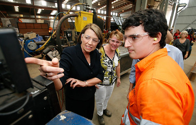 24 February 2009 Townsville, Qld - Queensland premier Anna Bligh talks with 3rd yr apprentice boilermaker Troy Porter during a visit to Townsville firm Pacific Coast Engineering on the first day of campaigning ahead of the March 21 election - Photo: Cameron Laird (Ph: 0418 238811)