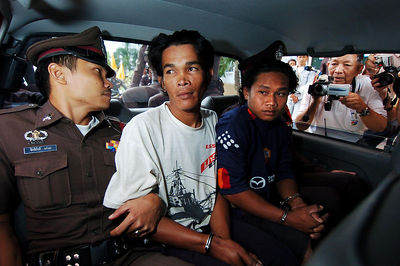SURATTHANI, THAILAND / 11 JAN 2006 - Murder of British backpacker Katherine Horton in Koh Samui, Thailand.  Wichai SomKhaoyai (white shirt) and Bualoi Posit (blue shirt) leave Suratthani Provincial Court after being formally charged with Katherine's murder - PHOTO: CAMERON LAIRD