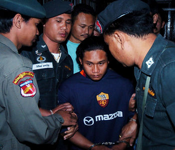 SURATTHANI, THAILAND / 11 JAN 2006 - Murder of British backpacker Katherine Horton in Koh Samui, Thailand.  Bualoi Posit is taken from Suratthani police holding cells for a court appearance to be formally charged along with Wichai SomKhaoyai of Katherine's murder - PHOTO: CAMERON LAIRD