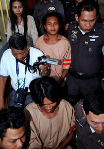 SURAT THANI, THAILAND / 13 JAN 2006 - Murder of British backpacker Katherine Horton in Koh Samui, Thailand.  Wichai SomKhaoyai (front) and Bualoi Posit, 23 (rear) leave Surat Thani court charged with the murder and rape of Katherine Horton - PHOTO: CAMERON LAIRD