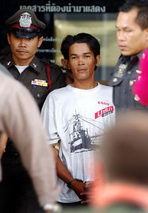 SURATTHANI, THAILAND / 11 JAN 2006 - Murder of British backpacker Katherine Horton in Koh Samui, Thailand.  Wichai SomKhaoyai leaves Suratthani Provincial Court after being formally charged along with Bualoi Posit of Katherine's murder - PHOTO: CAMERON LAIRD