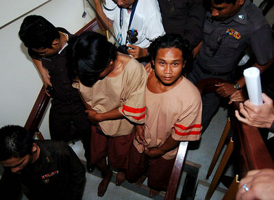 SURAT THANI, THAILAND / 13 JAN 2006 - Murder of British backpacker Katherine Horton in Koh Samui, Thailand.  Wichai SomKhaoyai (left) and Bualoi Posit, 23 (right) leave Surat Thani court charged with the murder and rape of Katherine Horton - PHOTO: CAMERON LAIRD