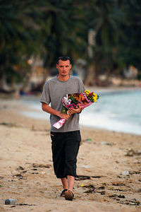 "KOH SAMUI, THAILAND / 05 JAN 2006 - Murder of British backpacker Katherine Horton in Koh Samui, Thailand.  Callum Macdonald who befriended Katherine on New Years Eve lays flowers at the ""New Hut Bungalows"" where they were staying - PHOTO: CAMERON LAIRD"