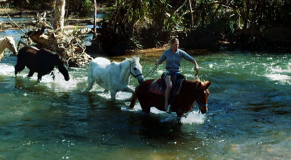 04 AUG 2006 CAIRNS, AUSTRALIA - (COLLECT IMAGES FROM DOCUMENTARY MAKER) Brit Anna Hingley and her Aussie cowboy boyfriend John Ostwald have just completed a west-east crossing of Australia on horseback - PHOTO: CAMERON LAIRD (PH: +61 418238811)