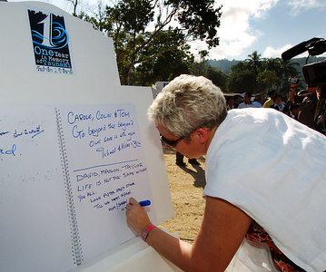 PHANG-NGA, THAILAND / 26 DEC 2005 - British tsunami survivor Sharon Howard signs a remembrance book.  She lost her two children Mason & Taylor and her partner David who had proposed to her the day before the tradgedy - Tsunami Victims Memorial Service, Bang Niang Beach, Phang-nga, Thailand - PHOTO: CAMERON LAIRD (PH +61 418238811)