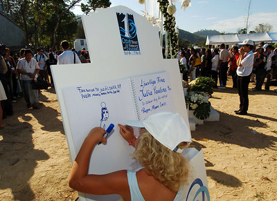 PHANG-NGA, THAILAND / 26 DEC 2005 - 6 year old Swedish tsunami survivor Micaela Sanden draws an angel on the remembrance book to represent her 9 year old sister Paulina who died in the disaster - Tsunami Victims Memorial Service, Bang Niang Beach, Phang-nga, Thailand - PHOTO: CAMERON LAIRD (PH +61 418238811)