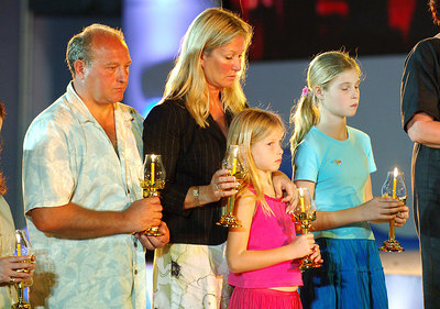 PHANG-NGA, THAILAND / 26 DEC 2005 - British tsunami hero Tilly Smith (right with sister Holly and parents Colin and Penny) was credited with saving her family and over 100 fellow tourists in the boxing day 2004 tsunami.  She read a poem in front of Crown Princess Ubol Ratana at an Interfaith Memorial Service at Bang Niang Beach, Phang-nga, Thailand - PHOTO: CAMERON LAIRD (PH +61 418238811)