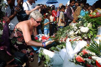 PHANG-NGA, THAILAND / 26 DEC 2005 - British tsunami survivor Sharon Howard lays flowers at the memorial.  She lost her two children Mason & Taylor and her partner David who had proposed to her the day before the tradgedy - Tsunami Victims Memorial Service, Bang Niang Beach, Phang-nga, Thailand - PHOTO: CAMERON LAIRD (PH +61 418238811)
