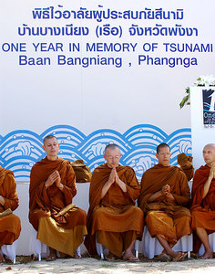 PHANG-NGA, THAILAND / 26 DEC 2005 - Buddhist monks at the Tsunami Victims Memorial Service, Bang Niang Beach, Phang-nga, Thailand - PHOTO: CAMERON LAIRD (PH +61 418238811)