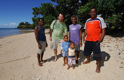 15 APR 2006 VOROVORO ISLAND, FIJI - Daily Mail photographer Cameron Laird with Vorovoro residents - PHOTO: RICHARD SHEARS (Ph: +61 418238811)