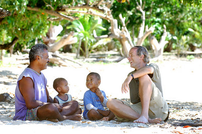 15 APR 2006 VOROVORO ISLAND, FIJI - Daily Mail writer Richard Shears chats with island deputy chief Poasa Tuitaqa and his two grandchildren - PHOTO: CAMERON LAIRD (Ph: +61 418238811)