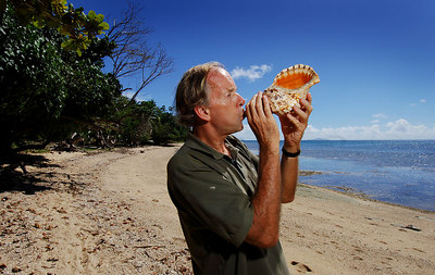 "15 APR 2006 VOROVORO ISLAND, FIJI - Daily Mail writer Richard Shears attempts to blow a calling note from a shell just like in ""Lord of the Flies"" - PHOTO: CAMERON LAIRD (Ph: +61 418238811)"