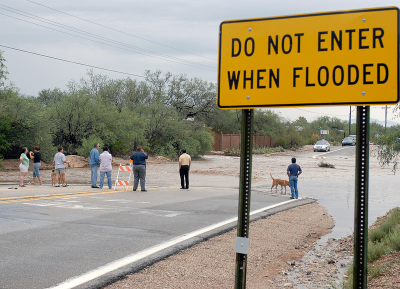 (7.31.2006 -- Tucson, AZ)  Bystanders watching the flooding at Harrison Road just south of Snyder.