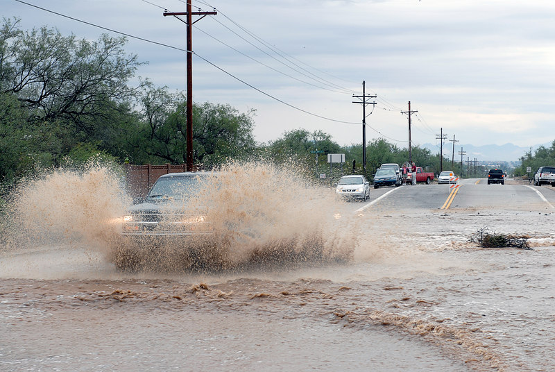 (7.31.2006 -- Tucson, AZ)  A driver unwisely traversing the flooded Harrison Road just south of Snyder.