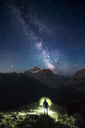 "<i>Tent light, a silhouette and The Lougheed Group from Wind Ridge,<br> Bow Valley Wildland Provincial Park,<br> <font size=""1"">Alberta, Canada</font></i>"