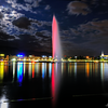 Colorful Lake Leman with Jet d'Eau at night - Geneva Lake, Switzerland