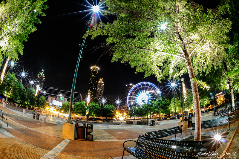 Centennial Olympic Park at Night with Centennial Tower ,The Ferris wheel and  Westin at backdrop - Atlanta, Georgia - USA