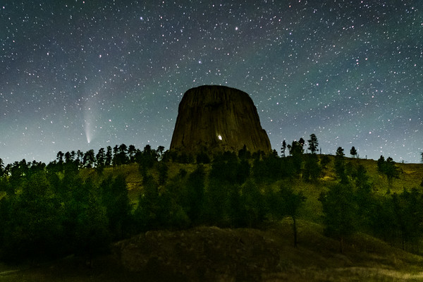 Devil's Tower at night with comet