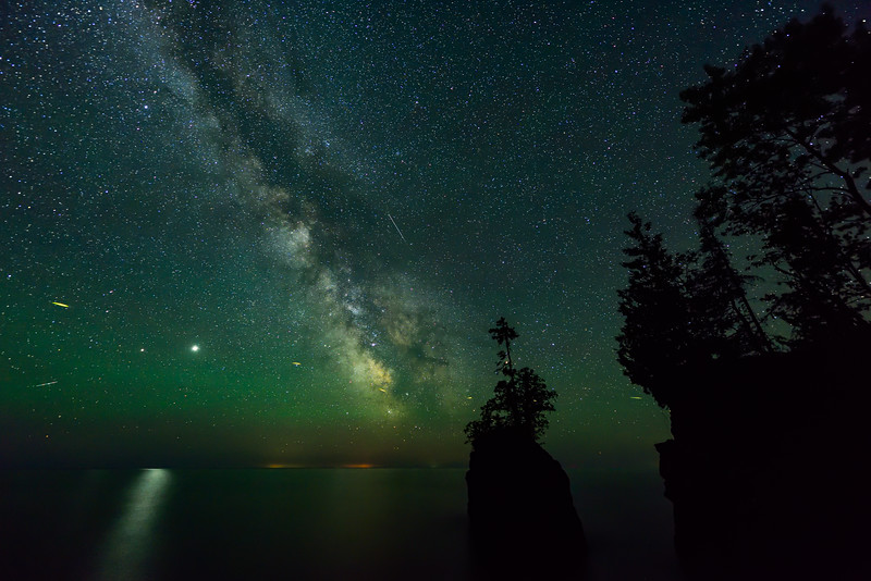 Milky Way and air glow over sea stack 01