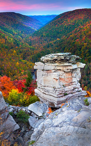 """Lindy Point Overlook""  Looking out over the Blackwater Canyon at Lindy Point in the fall is one of the most breathtaking locations you may find. The Blackwater State Park highlight is worth the short hike in the pitch black to capture the sun coming up over the mountains lighting the white rocks and setting the autumn colors ablaze.  This panoramic image was created using five images and stitching them together capturing a vertical image overlooking the canyon."