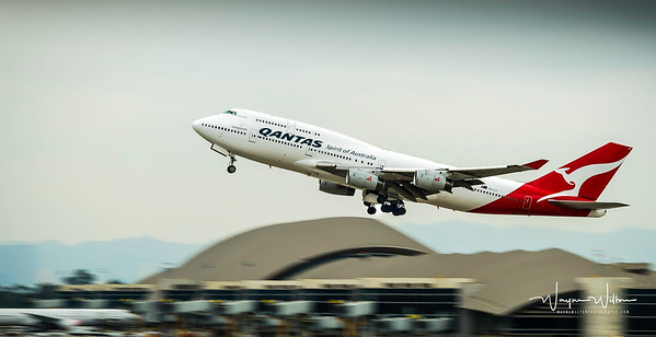 Qantas Boeing 747 takes off from LAX