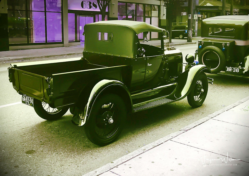 Movie set vehicles await their time in the spotlight in downtown Vancouver