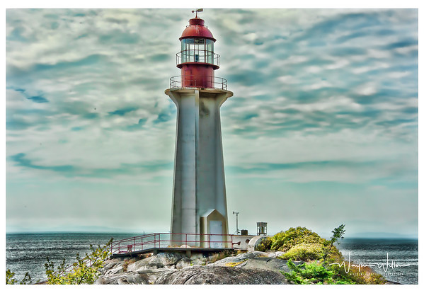The Point Atkinson Lighthouse has been standing guard over the entrance to Vancouver for decades . It is one the best known lighthouses on the west coast of Canada.