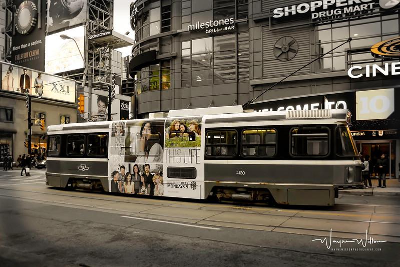 A Toronto streetcar waits to cross Yonge Street at Dundas