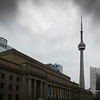 The CN Tower rises above Union Station in Downtown Toronto