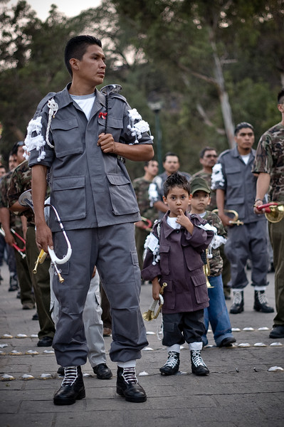 A father and his sons wait to play during the annual Miner's festival in Guanajuato, Mexico.