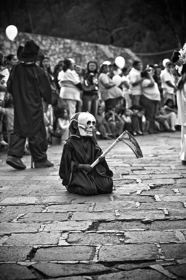 "A boy in Guanajuato, Mexico is dressed as Death, one of many characters in Mexico's traditional ""Danza del Toro"" often performed during various festivals in Mexico."
