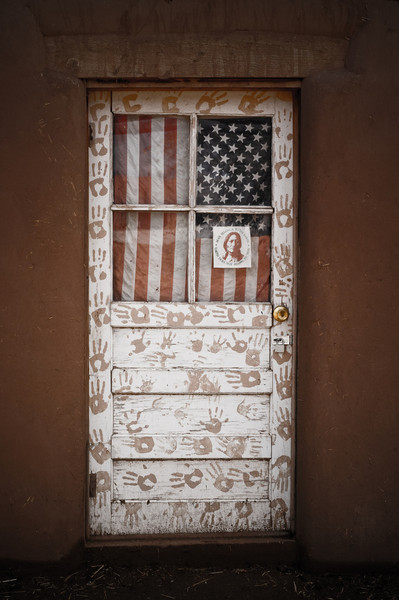 A hand painted Native American door in Taos Pueblo. Taos, New Mexico