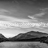 Llyn Padarn, Llanberis Pass and Snowdon at sunrise, monochrome. North Wales.