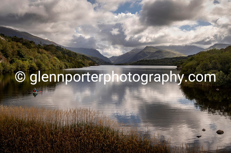 Llyn Padarn, Llanberis Pass and Snowdon in the clouds, North Wales.