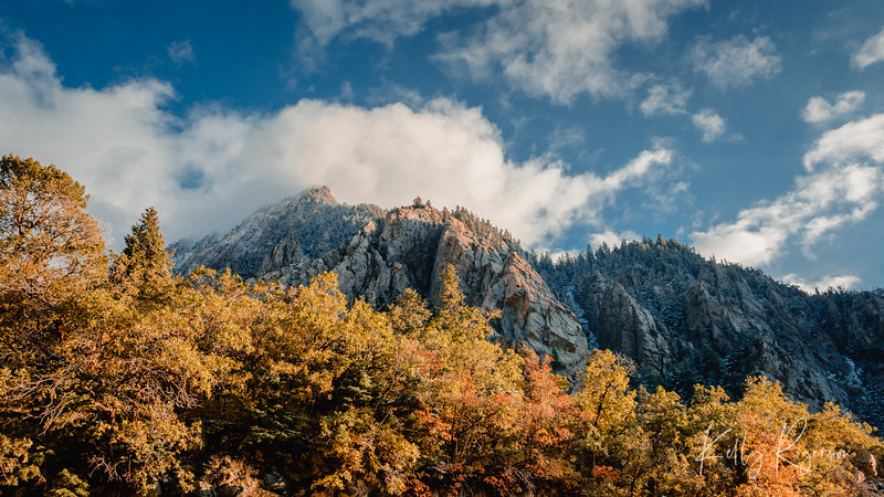 End of a day in Big Cottonwood Canyon, with the snow topped trees on the peak, and the fall colors still on the leaves below.