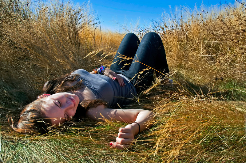 Laying in the sun in a feild  long yellow grass field