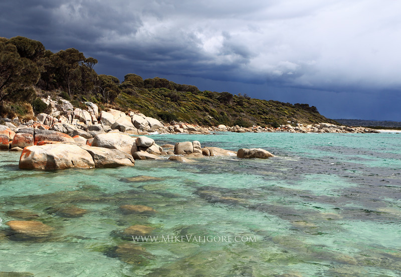 St. Helens<br /> Tasmania<br /> <br /> A break in the sky of an approaching storm yielded this amazing contrast of turquoise water and gray clouds.